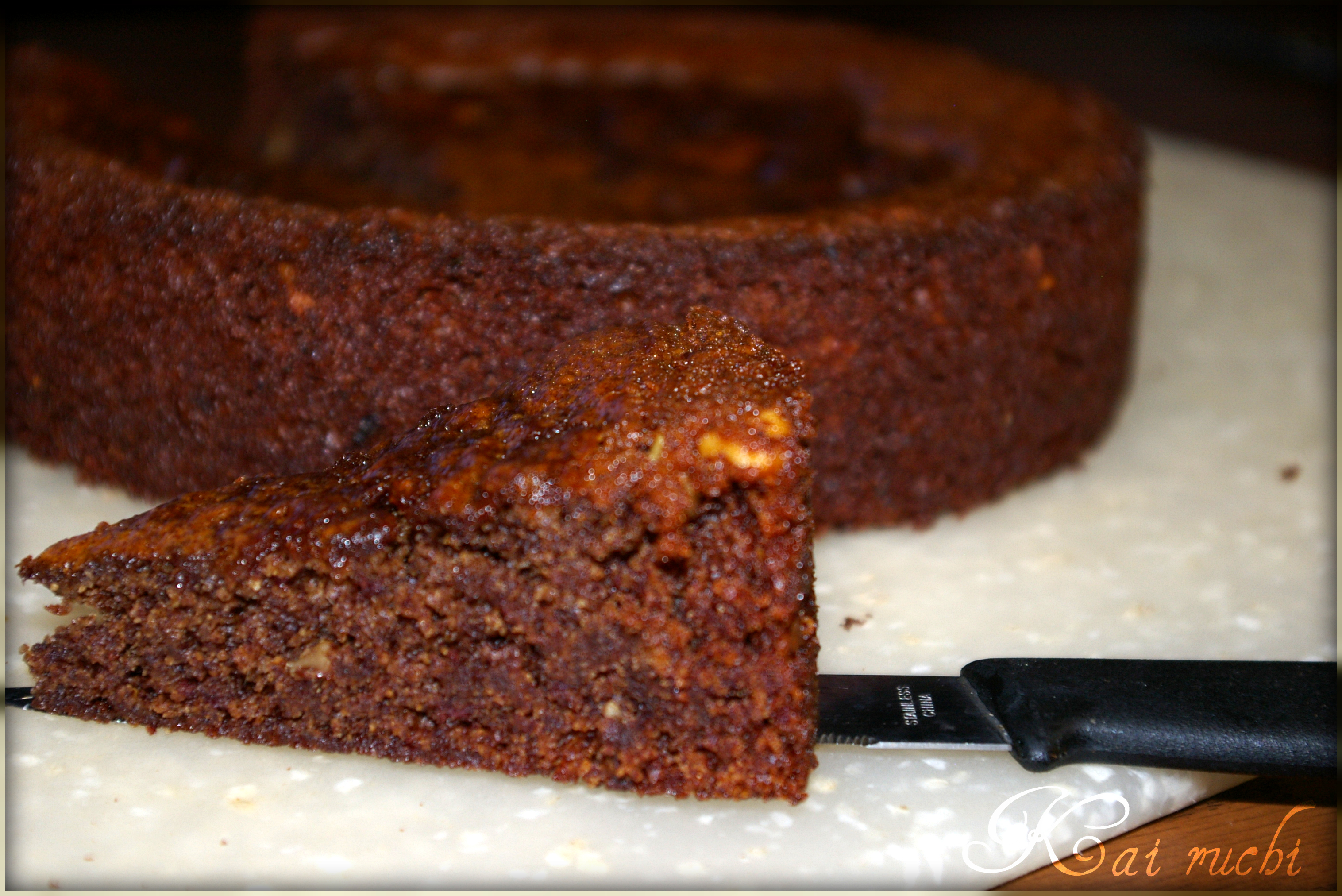 Date Cake is flecked with sweet chocolate chips and crunchy walnuts. A ...
